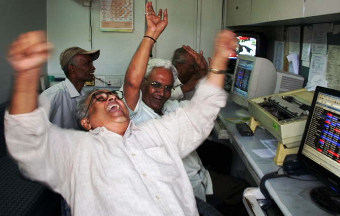 A file photo shows traders reacting inside a brokerage in Ahmedabad.