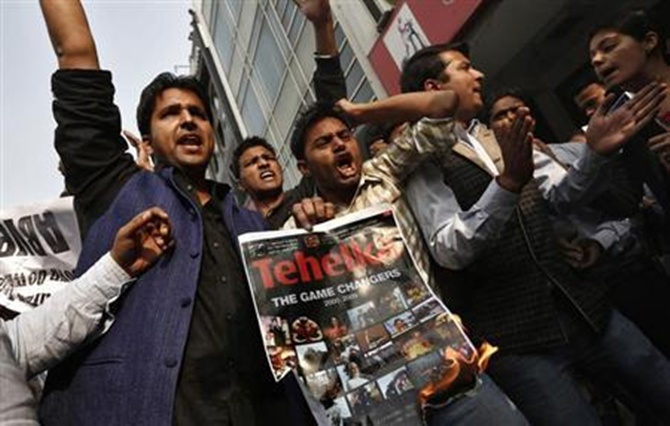Activists of the Akhil Bharatiya Vidyarthi Parishad (ABVP), linked to Bharatiya Janata Party (BJP), shout slogans during a protest against Tarun Tejpal.