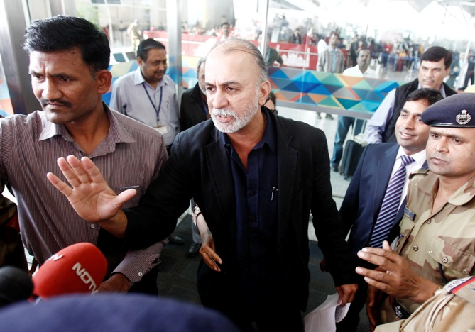 Tarun Tejpal, the 50-year-old founder and editor-in-chief of Tehelka, speaks with the media upon his arrival at the airport on his way to Goa.