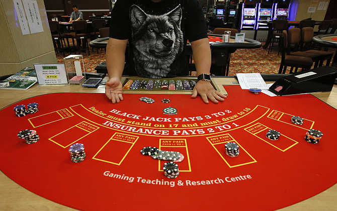 A student practices at a mock casino run by the Macao Polytechnic Institute in Macau.