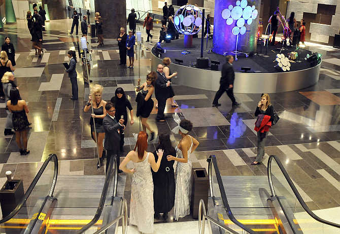 Guests mingle during a preview party at the grand opening of MGM Mirage's $8.5 billion CityCenter project centerpiece, Aria Resort & Casino, in Las Vegas, Nevada.