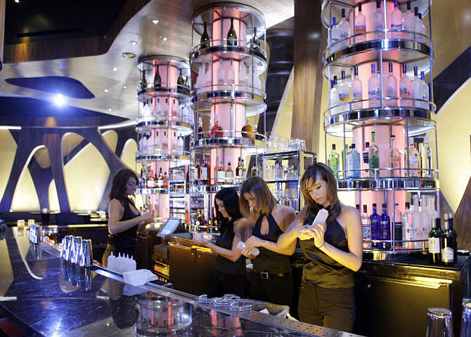 Employees ready the bar at the Union Restaurant and Lounge inside the Aria hotel-casino in Las Vegas, Nevada.