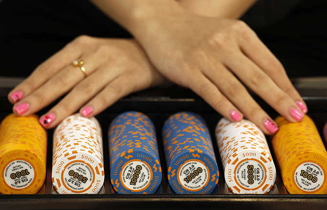 Test chips with security measures by Gaming Partners International, a provider of casino currency and equipment, are displayed on a gaming table during the Global Gaming Expo Asia in Macau.