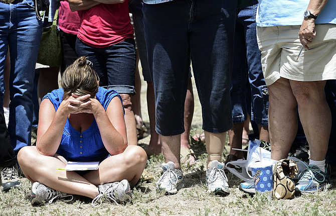 An evacuee lowers her head after hearing that residents are not going to be allowed to return to their homes yet, during a containment briefing on the Black Forest Fire near Colorado Springs, Colorado.