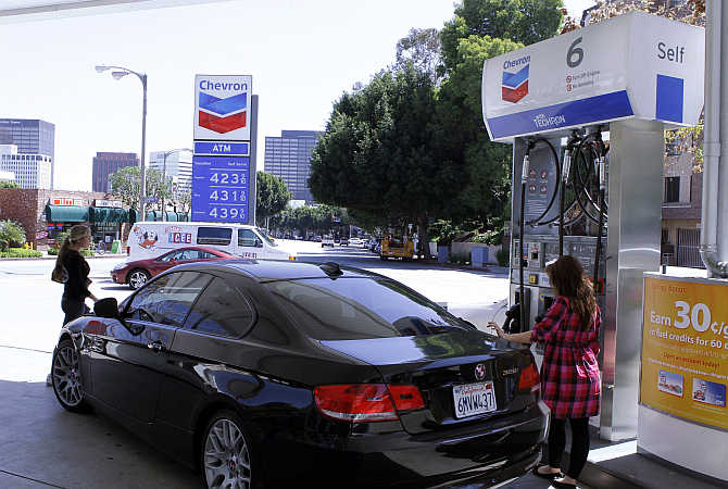 A woman stands at a petrol pump in Los Angeles,California.