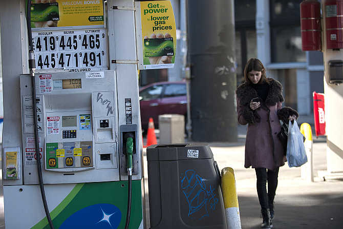 Fuel prices are displayed at a petrol pump in New York.