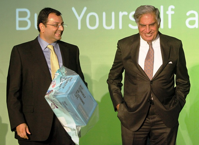Tata Group Chairman Ratan Tata (R) and Deputy Chairman Cyrus Mistry attend the launch of a new website for tech superstore Croma, managed by Infiniti Retail.
