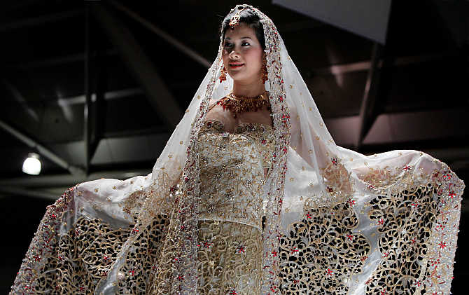 A model presents a creation by Indian designer Devki Karer for label DEVKI's at a fashion show in Singapore.