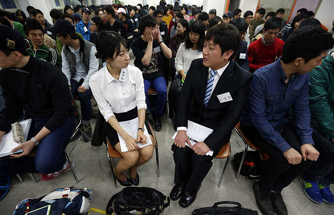 College students attend a class at a cram school in Busan, about 420km southeast of Seoul, South Korea. About 70 college students study for an exam they hope will guarantee them a job for life with Samsung Group.