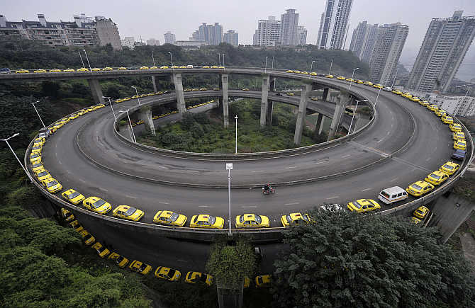 Taxis line up to get their tanks filled on a ramp in Chongqing municipality, China.