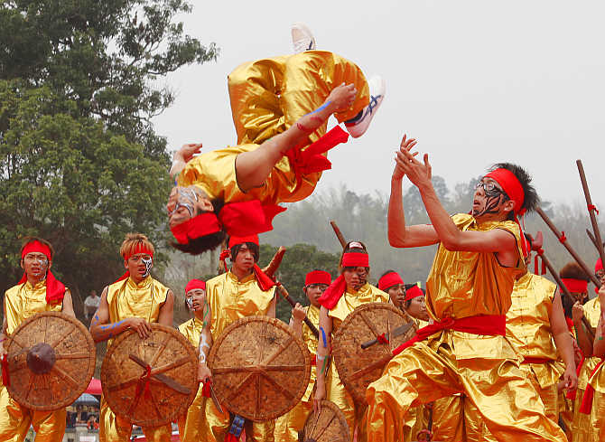A performer flips in the air during the Song Jiang Battle Array competition in Neimen, Kaohsiung County, Taiwan.