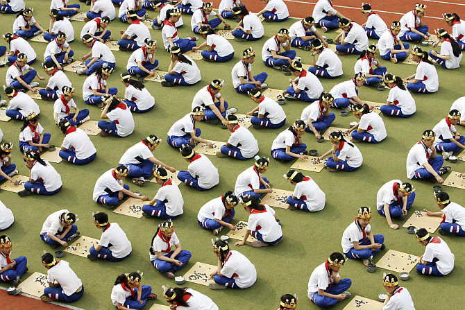 Students play the board game 'Go', known as 'Weiqi' in Chinese, at a primary school in Suzhou, Jiangsu province.