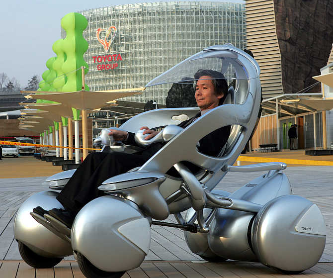 A man rides Toyota Motor's one-seater 'i-unit' vehicle in Nagoya, Japan.