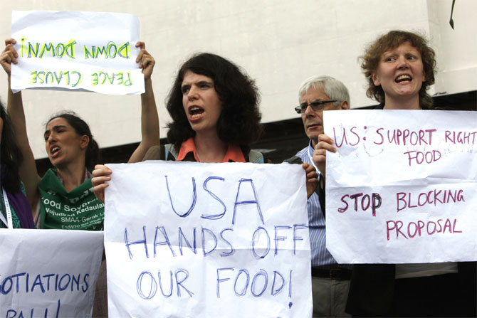 Protesters shout slogans about food security.