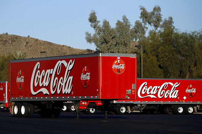 Coca Cola trailers sit parked outside the bottling company building in Tempe, Arizona.