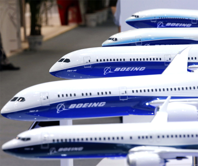 A visitor looks at a display of miniature Boeing passenger aircraft at Aviation Expo.