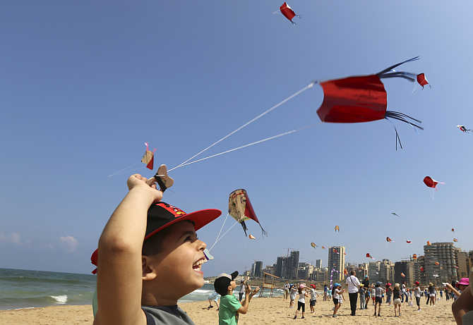 Children fly their kites during an Interschool Kite Meetings in Beirut, Lebanon.