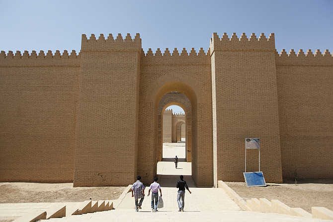 Visitors enter the ancient city of Babylon near Hilla, 100km south of Baghdad, Iraq.