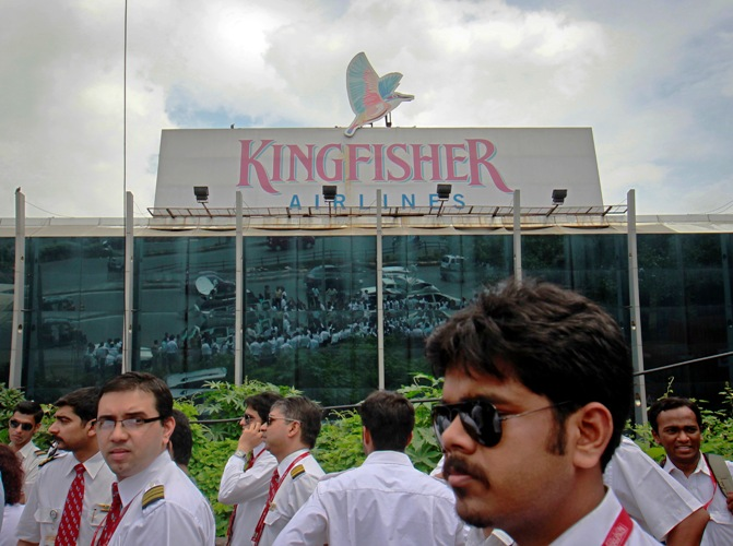 Striking employees stand in front of the Kingfisher Airlines office during a protest march against the company in Mumbai October 5, 2012.