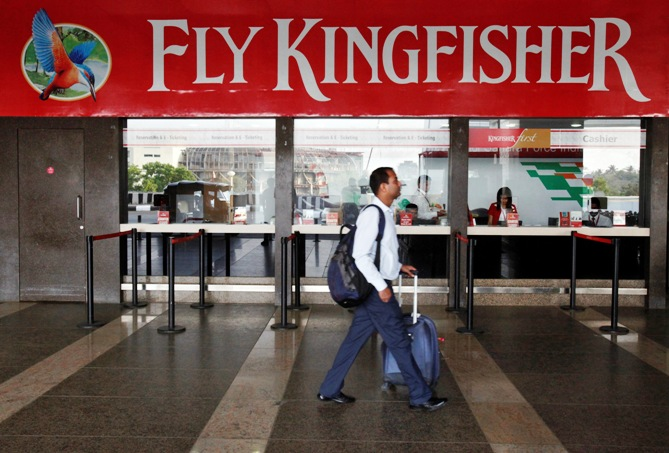 A passenger walks past a near-empty Kingfisher airlines ticketing office at Mumbai's domestic airport March 27, 2012.