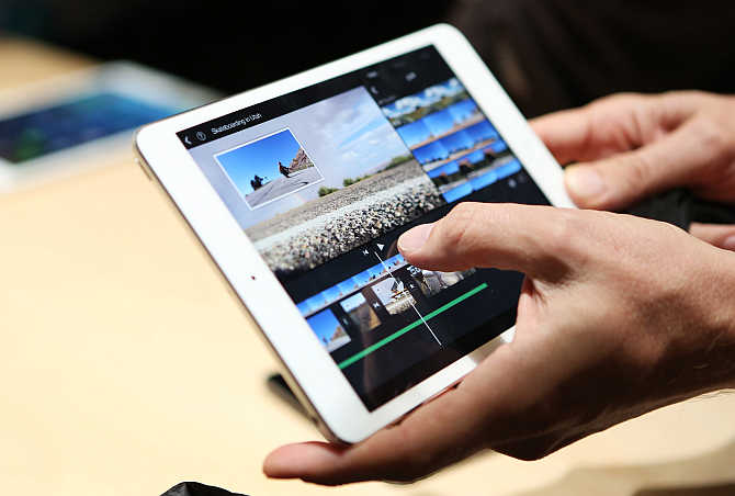 A member of the media holds the iPad Mini with Retina Display in San Francisco, California.