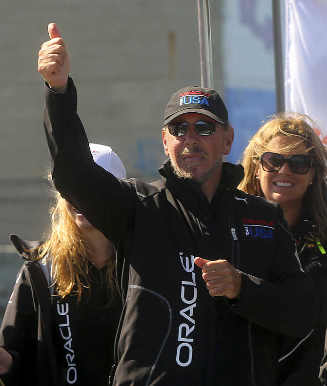 Oracle CEO Larry Ellison gestures after Oracle Team USA defeated Emirates Team New Zealand during Race 18 of the 34th America's Cup yacht sailing race in San Francisco, California.
