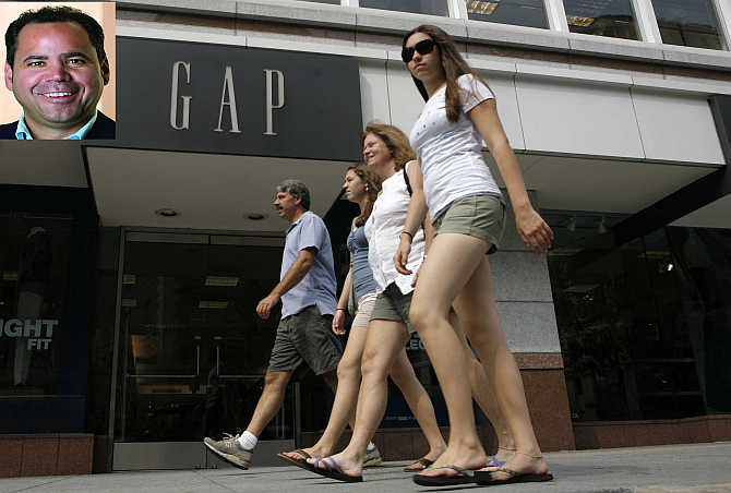 Pedestrians pass by a Gap clothing store in Washington. Inset, Glenn Murphy.