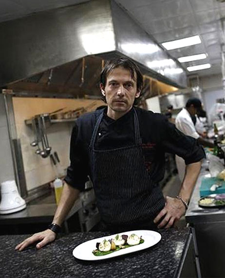 Matteo Boglione, executive chef of Le Cirque Signature restaurant, poses for a picture inside the kitchen in Mumbai