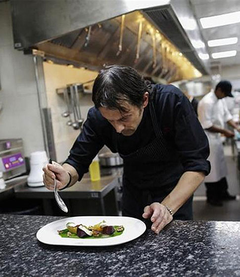 Matteo Boglione, executive chef of Le Cirque Signature restaurant, prepares a dish inside the kitchen.