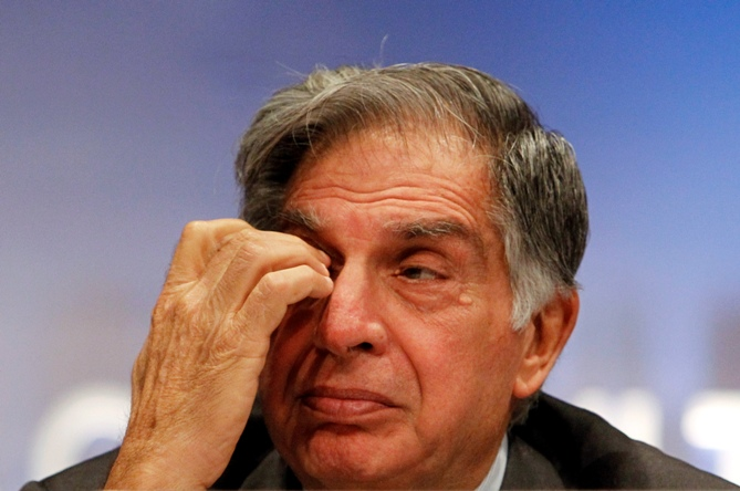 Ratan Tata wipes his eye during an annual general meeting of Tata Consultancy Services in Mumbai.