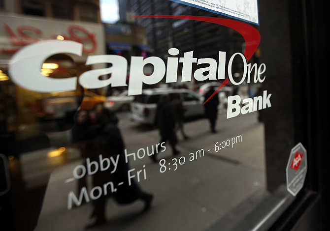 People walk past a Capital One banking centre in New York's financial district.