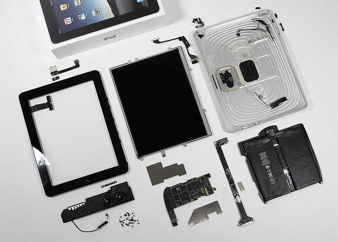 Components of an iPad are laid out during a teardown by iFixit's Luke Soules in Glen Ellen, Virginia. Apple's iPad includes chips from Samsung Electronics Broadcom and Texas Instruments.