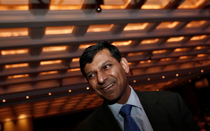 Reserve Bank of India Governor Raghuram Rajan smiles as he arrives to attend Delhi Economics Conclave 2013 in New Delhi.