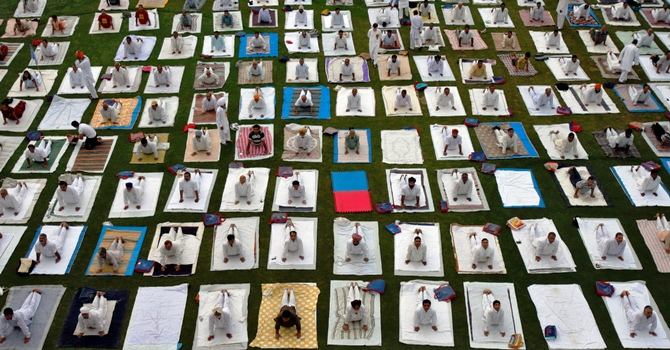 People participate in an early morning yoga session in Chandigarh.