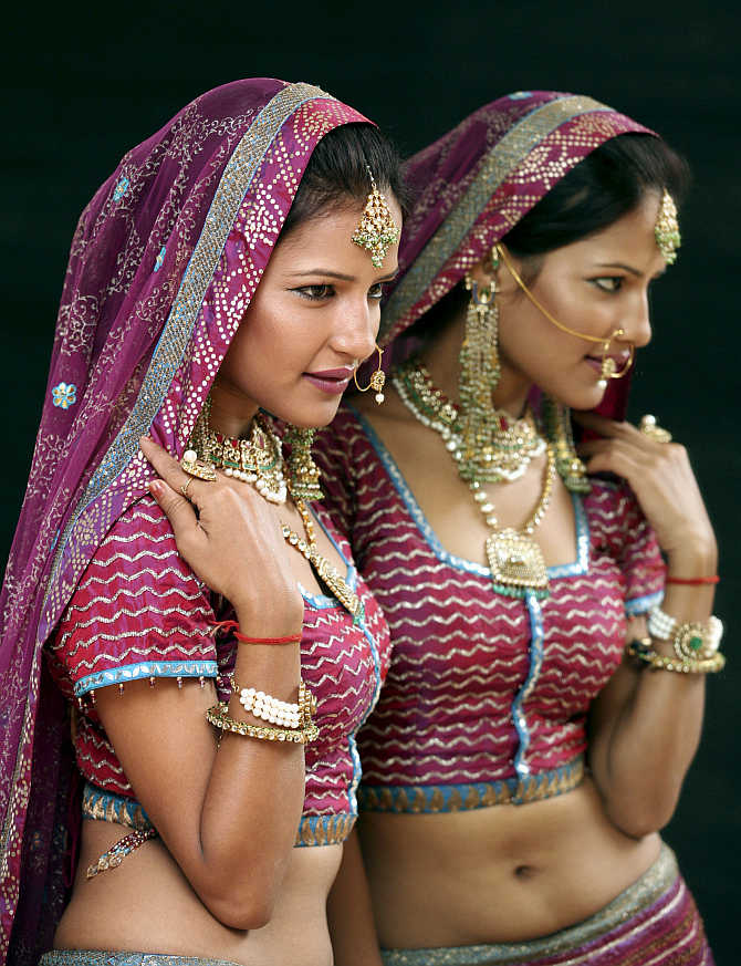 A model displays jewellery during an exhibition in Chandigarh.