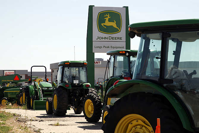 John Deere commercial vehicles parked at a dealer in Longmont, Colorado.