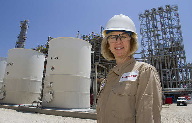 Eastman Chemical site manager and chemical engineer Cari Parker in front of tanks of plasticizer product at the plant in Texas City, Texas.