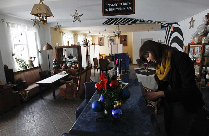 A waitress prepares coffee at a Seventh Heaven restaurant in the centre of the Town of Pabianice, Poland.