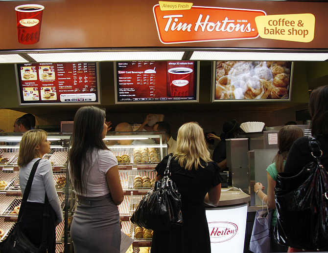 Customers wait at a Tim Hortons coffee and bake shop at Penn Station in New York.