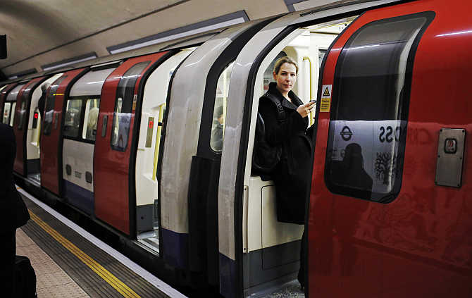 A woman waits for a tube train to depart at an underground station in London, United Kingdom.