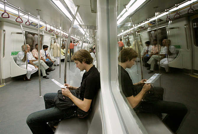 Passengers sit inside a carriage of the Metro train in New Delhi.
