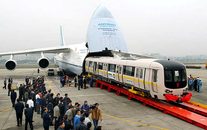 Two underground train carriages are unloaded from a cargo transport plane at Baiyuan International Airport in Guangzhou, Guangdong province, China.