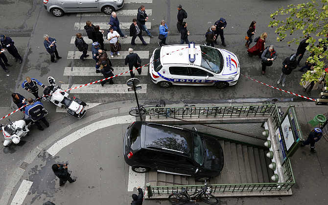 Police gather at the entrance to the Chaussee d'Antin La Fayette Metro station after a car accidentally drove into it in Paris, France.