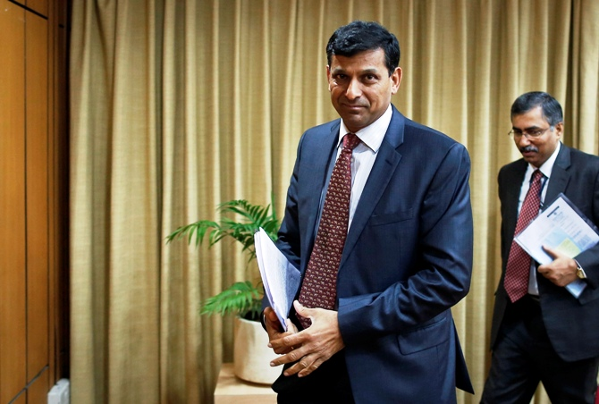 Reserve Bank of India (RBI) Governor Raghuram Rajan leaves after a news conference for the mid-quarter monetary policy review at the RBI headquarters in Mumbai.
