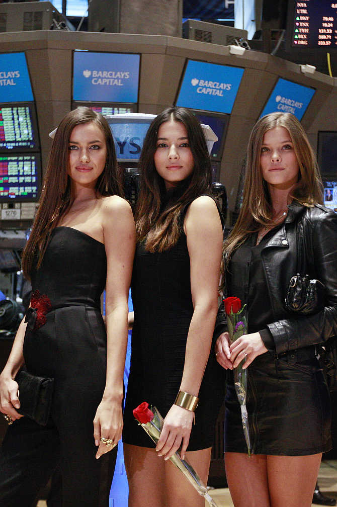 Sports Illustrated Swimsuit models on the floor of a stock exchange in New York.
