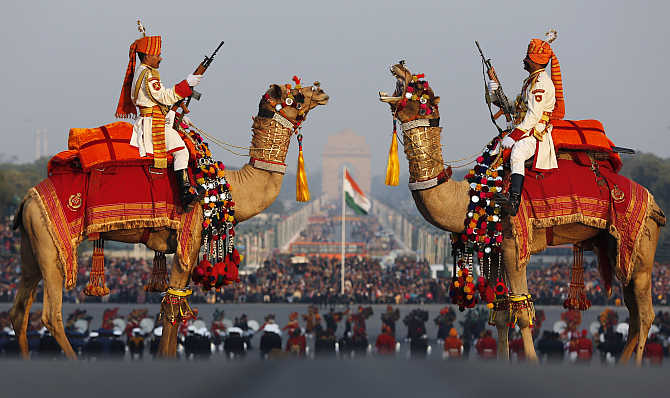 Border Security Force soldiers ride their camels as they rehearse for the 'Beating the Retreat' ceremony in New Delhi.