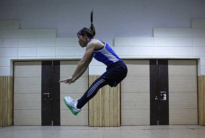 Boxer MC Mary Kom exercises during a training session at Balewadi Stadium in Pune.
