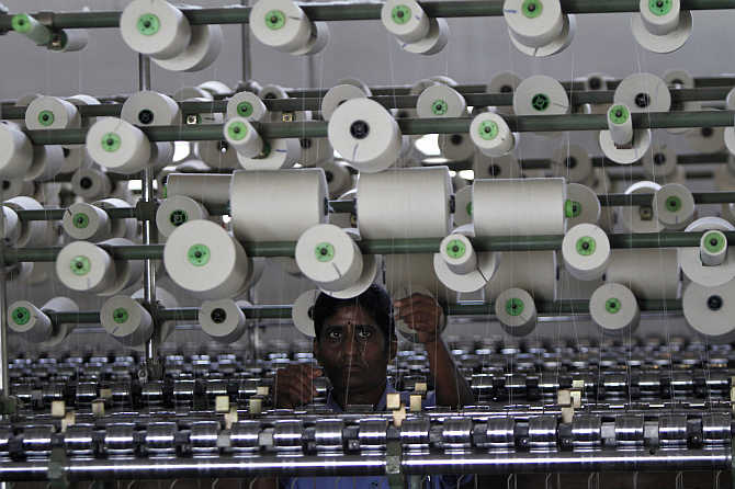A worker tends to yarn-spinning equipment at a factory in Coimbatore.