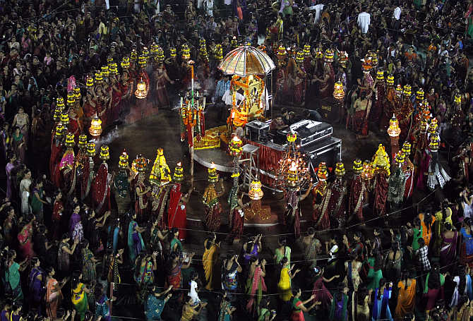 Devotees perform Garba during the celebrations to mark the Navratri festival in Surat.