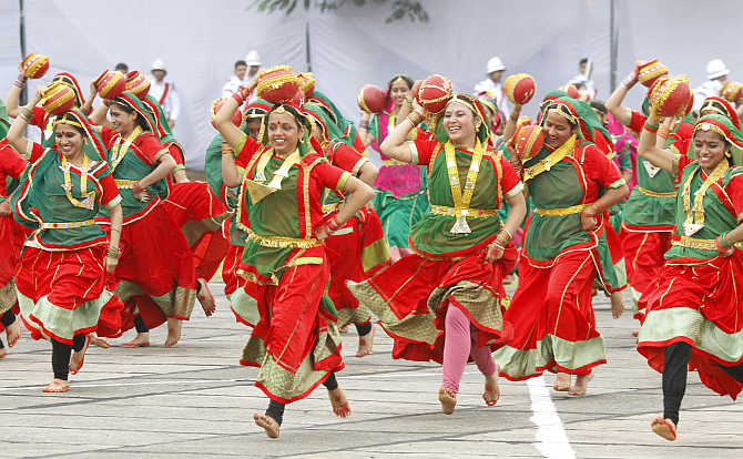 Participants perform a folk dance in Chandigarh.